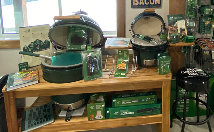 An arrangement of Big Green Egg grills and accessories
