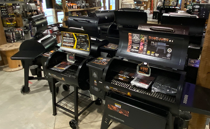 An array of open black grills displaying their price
