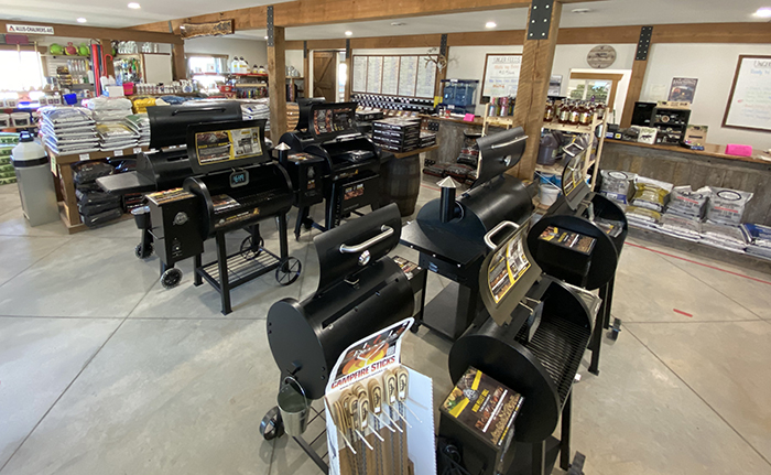 Several open grills on a floor display